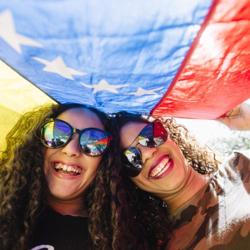 Young girls with flag of Venezuela